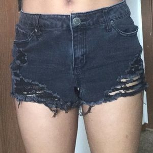 Ripped black summer shorts. They rise a little.